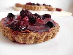 Recipe for Fruits of the Forest Tarts | - homemade shortcrust #pastry carts covered in blackcurrant Jello and delicious mixed berries. The perfect light summer #dessert! Get the #recipe here: http://pinkrecipebox.com/fruits-of-the-forest-tarts/