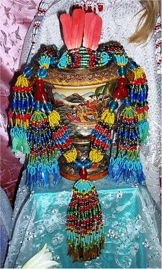 Shrine set up with Beaded Mazo and a beautiful porcelain container! For Erinle, Orisha of Healing and Medicine.