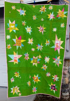 """60"""" x 84""""  I used Kona Grass and the darker green is Kona Perdot which was just a bolt labeled wrong and I didn't know until the top was all put together.  Bound with Mingle by Robert Kauffman pink & green circles.  Quilted by the amazing  Christina"""