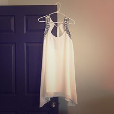 BEAUTIFUL NEW BCBG Make an offer and we'll see what we can do!  Beautiful, new BCBG dress! Only worn for about four hours during a photo shoot, never worn again. Beautiful white, with black detail. No trades please! BCBGeneration Dresses Asymmetrical
