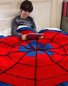 Free Crochet Pattern Spider Web Throw From RedHeart.com. It's past Halloween but it doesn't mean a child wouldn't love this as a gift!