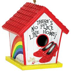 Decorated with a rainbow, ruby slippers, and a red-shingled roof, this ornamental birdhouse is a bright accent to your home or yard-and a place your feathered friends can call home!