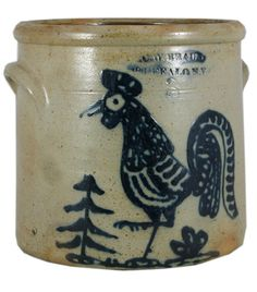 """SOLD - $ 47,300 March 2008 C. W. BRAUN BUFFALO NY 3 gallon crock. Decorated with a fabulous crowing rooster design with a tree in the background. Wonderful detail to this American Folk Art classis design. Additional blue at the deeply impressed maker's mark. Great blue.   Excellent.     10"""" 1860."""