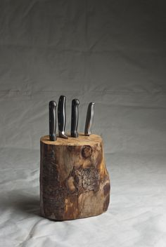 Log Knife Block Made from salvaged logs Dimensions: 230 x 200mm Accommodates a variety of knife sizes Please Note: Variations in size of knife bloc...