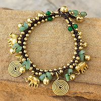 Aventurine charm bracelet, 'Splendor of Siam' by NOVICA Tiraphan Hasub captures the charm of old Siam with the design of this bracelet featuring golden elephants. Accompanied by spirals and ringing bells, the brass charms alternate with aventurine. $28