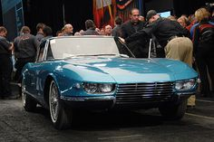 """Barrett-Jackson 2008: Chevrolet Corvette Rondine Concept hits $1.76 million. Pininfarina, meet Corvette. Corvette, Pininfarina. This one-off 1963 concept car was created for the Paris Auto Show and has been stored at the Pininfarina museum since new. Chevrolet commissioned the design house to build the car, which is based on a 1963 Corvette chassis and has a 327cid/360-hp V8 under the hood. The car has a much more European feel, and features fixed headlights and a """"swallow tail"""" rear end."""