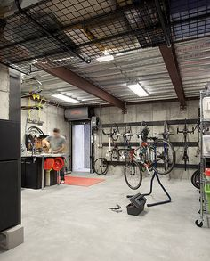 A modern family home for racing bike enthusiasts – Sustainable Architecture with Warmth & Texture - Garage shop Garage Ceiling Storage, Garage Storage Racks, Garage Storage Solutions, Bike Storage, Storage Ideas, Garage Organization, Tool Storage, Storage Bins, Outdoor Bicycle Storage