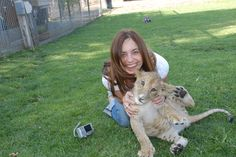 Lauren with the lion cubs at Lions, Tigers and Bears Rescue Santuary, Alpine, Ca.