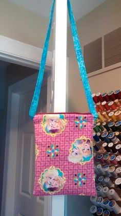Frozen cross-body bag in pink and turquoise