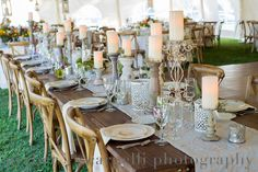 """Tented vintage head table design by """"WOW"""" Event Design and Coordination created with miscellaneous white washed candlepillars Photos by Gerber + Scarpelli  #wedding #vintagedecor #vintage #whitewashed #garden #tentedwedding #headtable"""
