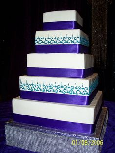 Purple and Teal wedding cake.....kinda like it. Maybe not so much purple