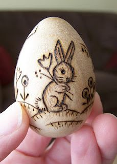Wooden Easter Eggs - so many cute designs, and I think she sells them on Etsy