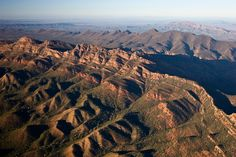 Aerial view of jagged peaks and foothills along Wilpena Pound, Flinders Ranges National Park.  Photo Credit: Bill Bachman