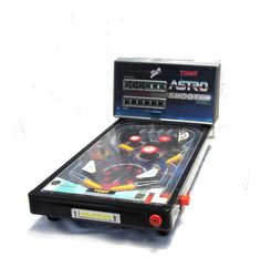 Working. Needs a 12V adaptor. Vintage game. Electronic game. Japanese toys. Arcade. Arcade game. Pinball. Pinball game. Tabletop pinball machine. TOMY Astro Shooter. Measures : 25 high 29 cm wide and 51 cm long ( multiply by 0.39 for inches ). Weight : about 3 kg.
