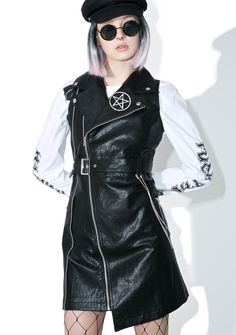 Disturbia Damned Jacket  squeeze the throttle and burn some rubber, babe! Do the damn thing in this badass longline sleeveless biker jacket featuring vegan leather, full lining, metal pentagram badge, detachable triple belt chains, asymmetrical hemline and front zipper closure.