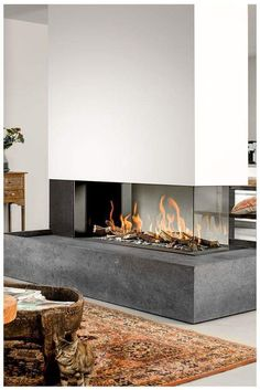 Incredible Contemporary Fireplace Design Ideas Natural or artificial fireplace models can make both modern and rustic home decorations look highly aesthetic. Artificial fireplace models are general. Home Fireplace, Living Room With Fireplace, Gas Fireplaces, Fireplace Ideas, Fireplace Modern, Fireplace Garden, 3 Sided Fireplace, Brick Fireplace, Interior Design Living Room