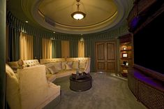 Wood home theater room with a large semi-circle sofa
