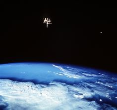 Russia's Mir space station and the Moon share the frame with a stormy Earth in this June 1998 photo taken from the Space Shuttle Discovery during mission STS-91. Wow. (NASA)
