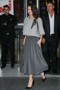 """I love the volume—it's like a modern take on the 'new look.' "" Selena is wearing a Co top and skirt"