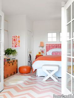 """The master bedroom has a very retro feel to it with the pink, tangerine, and lavender color palette, the paisley linen, and the zigzag Missoni-esque pattern on the floor,"" says designer Mona Ross Berman."