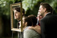 Hanging a frame outside so people can take funny/sweet/silly pics at the wedding!  — Lucy