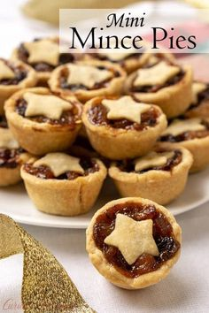 Mince Pies are a British Christmas staple. These sweet and boozy mini fruit pies are the perfect recipe to add to your Holiday cookie platter! #pie #mini #holidaybaking #cookies #Christmascookies #mince | www.CuriousCuisiniere.com