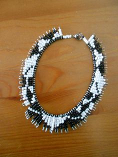 Safety pin and seed bead necklace in black and white