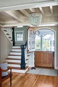 foyer with dutch door and beaded chandelier