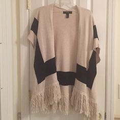 Forever 21 Fringe Sweater For 2 weeks only!! I'm home for Christmas and this is apart of my NY closet. Once I return back to California on 12/29, this will no longer be for sale-- this is a cream and black colored open front sweater with fringe bottom. From forever 21, size small! Forever 21 Sweaters Shrugs & Ponchos