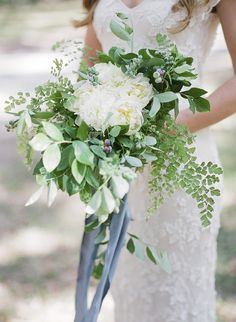 Love the green in this bouquet. with a peachy or champagne flower and a pop of lavender. thoughts Liz?