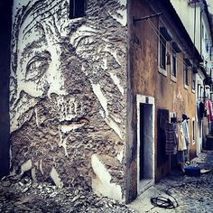 NEW VHILS IN LISBON, PORTUGAL  Using a slow archaic method of chipping away at surfaces street artist, Vhils, creates striking portraits with meticulous detail only subtle chips can create.  This newest work of his is located in Lisbon, Portugal.