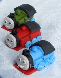 "Fondant 1.5"" x 1"" cupcake toppers.  6 for $27!  Custom details too!  Or just order 3 and place them on a regular 13 x 9 cake.  Arrange them in a semi-circle all facing the words ""Choo choo Graham is 2!""."