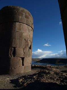 Sillustani is a pre-Incan burial ground on the shores of Lake Umayo near Puno in Peru. The tombs, which are built above ground in tower-like structures called chullpas, are the vestiges of the Colla people, Aymara who were conquered by the Inca in the 15th century. The structures housed the remains of complete family groups, although they were probably limited to nobility. Many of the tombs have been dynamited by grave robbers, while others were left unfinished