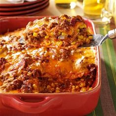 Enchilada Casserole Recipe -I get satisfied reviews every time I serve this—even from my father, who usually doesn't like Mexican food. It smells delicious while baking. —Nancy VanderVeer, Knoxville, Iowa