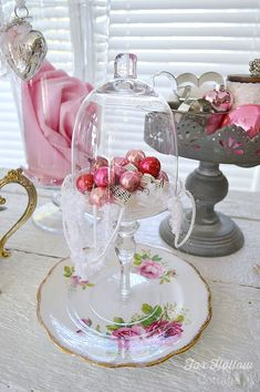 Cupcake cloche with vintage mini glass ornaments in pink and red - Valentine's Day Decorating Ideas using Christmas ornaments and vintage goods.