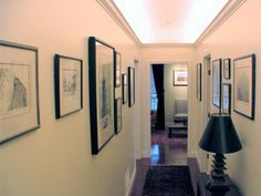 In a home where a hallway doubles as a gallery for framed artwork, cove lighting is used to provide both ambient and accent lighting. Low-voltage frosted halogen lightbulbs are concealed in cornice molding placed several inches below ceiling height. A table lamp is used as night lighting for the hallway. Lighting design by Markus Earley, Providence, R.I. Photo by Markus Earley