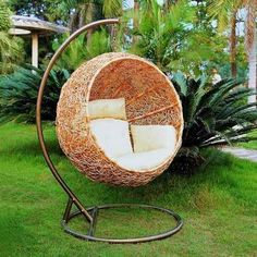 Furniture, Cool Hanging Chairs for Awesome Sensation : Eco Friendly Exterior Decor Ideas With Modern Round Hanging Chair Beside Leafy Plant ...