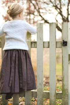 Easy, beginners sewing photo tutorial for a modest toddler or girls skirt with an elastic waistband and tie backs.
