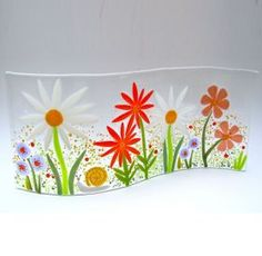 Small Glass Double Curved Arc Garden. A curved panel of very cheerful and exuberant garden flowers with a snail putting in an appearance on this piece! Each piece of glasswork is individually made Somerset with Bullseye fusing glass and dichroic glass and uses a range of different techniques to achieve the finished look for each piece.