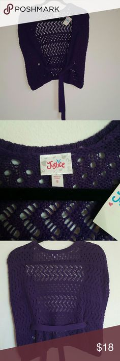 Justice Purple Sleeveless Sweater Vest (size 8) This sleeveless sweater is new with tags and it is in a beautiful deep purple. It is made of 62% cotton and 38% acrylic. It has a belt that goes all around the waist that ties in the front. Since it is a vest the opening for the arms are wide.  It would defiantly look good with a white tank under.   *Ships out next day, bundle to save 15% off entire purchase* Justice Shirts & Tops Sweaters