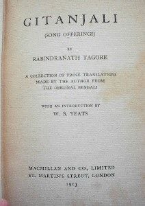 """Close-up of yellowed title page in an old book: """"Gitanjali (Song Offerings) by Rabindranath Tagore. A collection of prose translations made by the author from the original Bengali with an introduction by W. B. Yeats. Macmillan and Co., Limited, St. Martin's Street, London, 1913."""""""