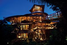 The Bali Bamboo Mansion |  This tree house in Bali was constructed almost entirely of bamboo. Its rounded and curving shape accentuates the naturist feel that comes from an all bamboo house. More than just a tree house, this six story mansion stands on 60 foot poles, elevated high in the canopy and blending in with the surrounding trees.