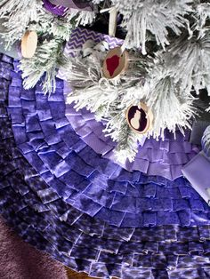 Put the finishing touch on your tree with an elegant and feminine linen skirt. The only tools you'll need are scissors and glue to make this easy no-sew ruffled tree skirt.