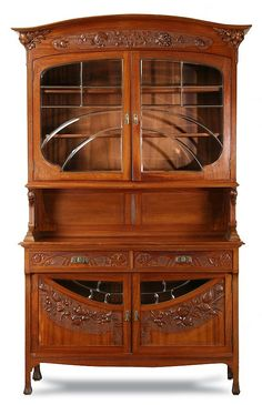 century French Art Nouveau walnut vitrine, with flared cornice supported by carved pomegranates, over a relief c. Furniture Styles, Unique Furniture, Vintage Furniture, Geek Furniture, Pallet Furniture, Furniture Ideas, Outdoor Furniture, Art Nouveau Furniture, Art Nouveau Design