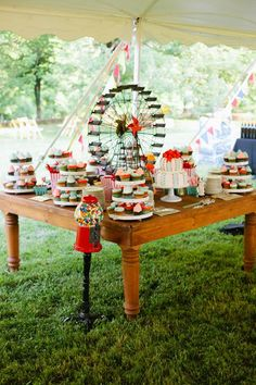 This carnival-inspired dessert table is perfect for a summer wedding!