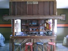 Our customer wanted the feel of an old country store porch and we came up with this bar. It has a swinging door on each side.