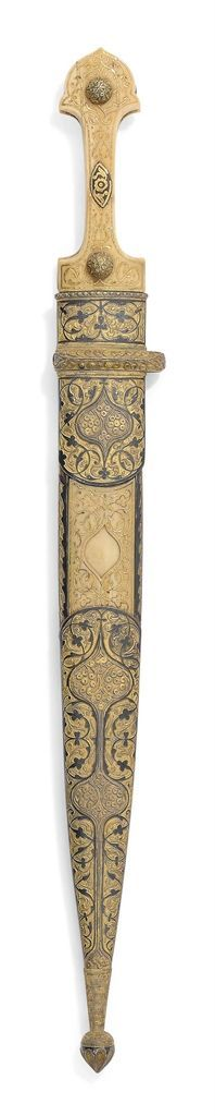 A FINE WALRUS IVORY-HILTED GILT AND NIELLOED KNIFE (KINJAL) SIGNED MAJID DHIMMI(?), OTTOMAN CAUCASUS, DATED AH 1292/1875-6 AD