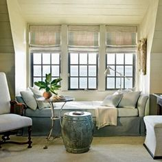 This is not really a window seat, but a bed placed in the window alcove works just