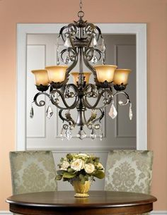 A traditional wrought iron and crystal chandelier picture.
