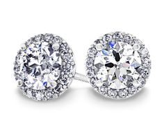 Halo Diamond Earrings in Platinum (1 1/2 ctw)  These diamond earrings feature a round cut center diamond encircled by a halo of pave diamonds set in platinum. 1 1/2 carat total diamond weight and proudly made in the USA http://www.brilliance.com.